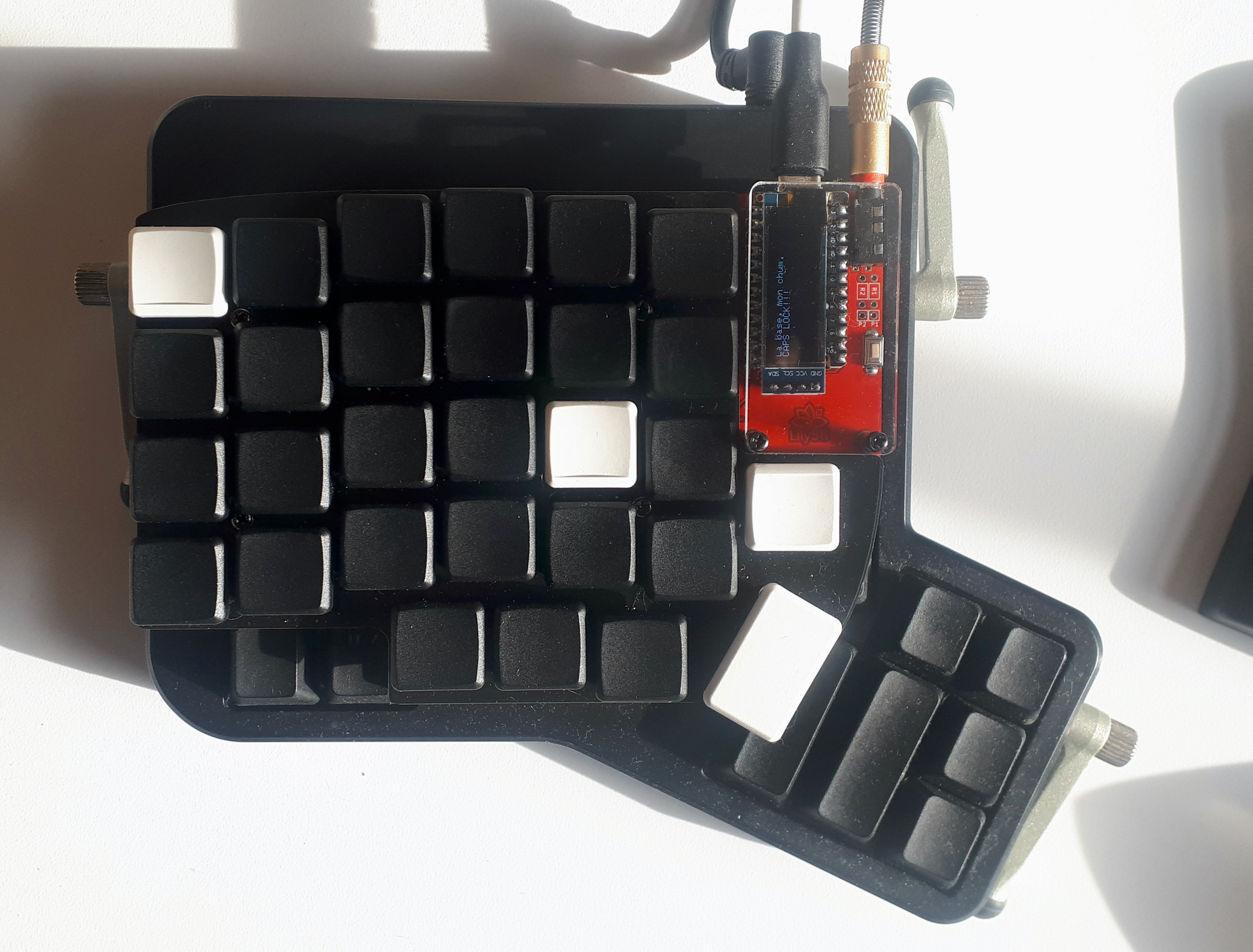 Lily58 on top of an Ergodox. Lily58 is smaller.