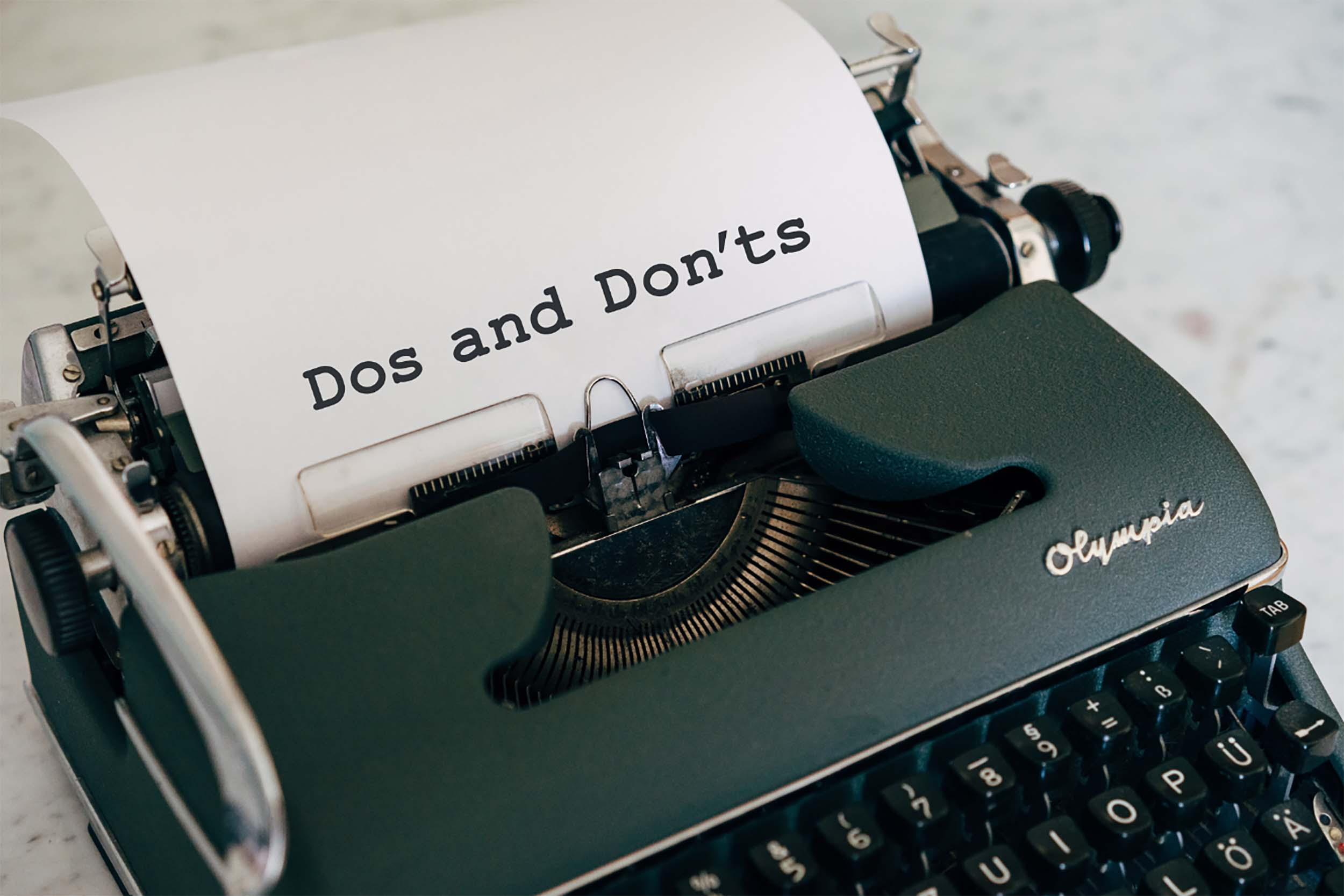 Typewriter with Do's and Don'ts title typed out on a piece of paper