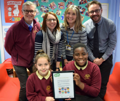 Staff and pupils at The Oaks school making their reading pledge