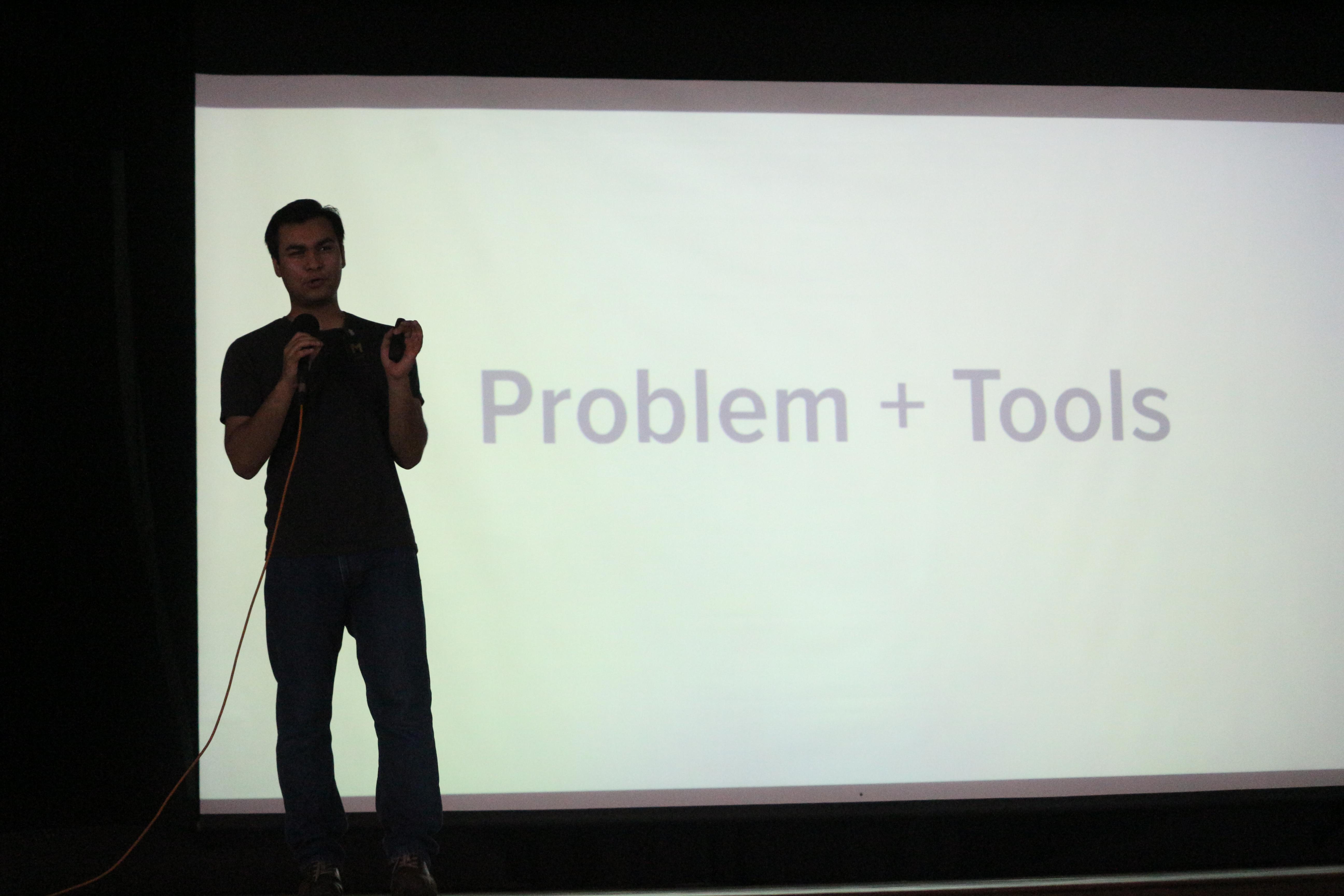 Anand Chowdhary explaining Problems + Tools slide