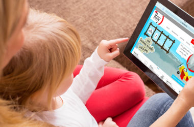 Image of child playing game on iPad