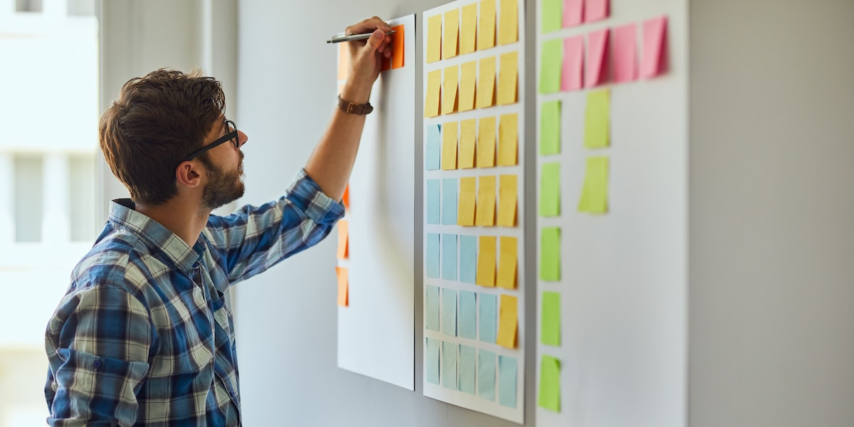A UX designer working on a project board