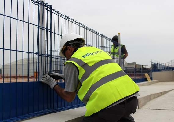 Fitting edge protection barrier fencing