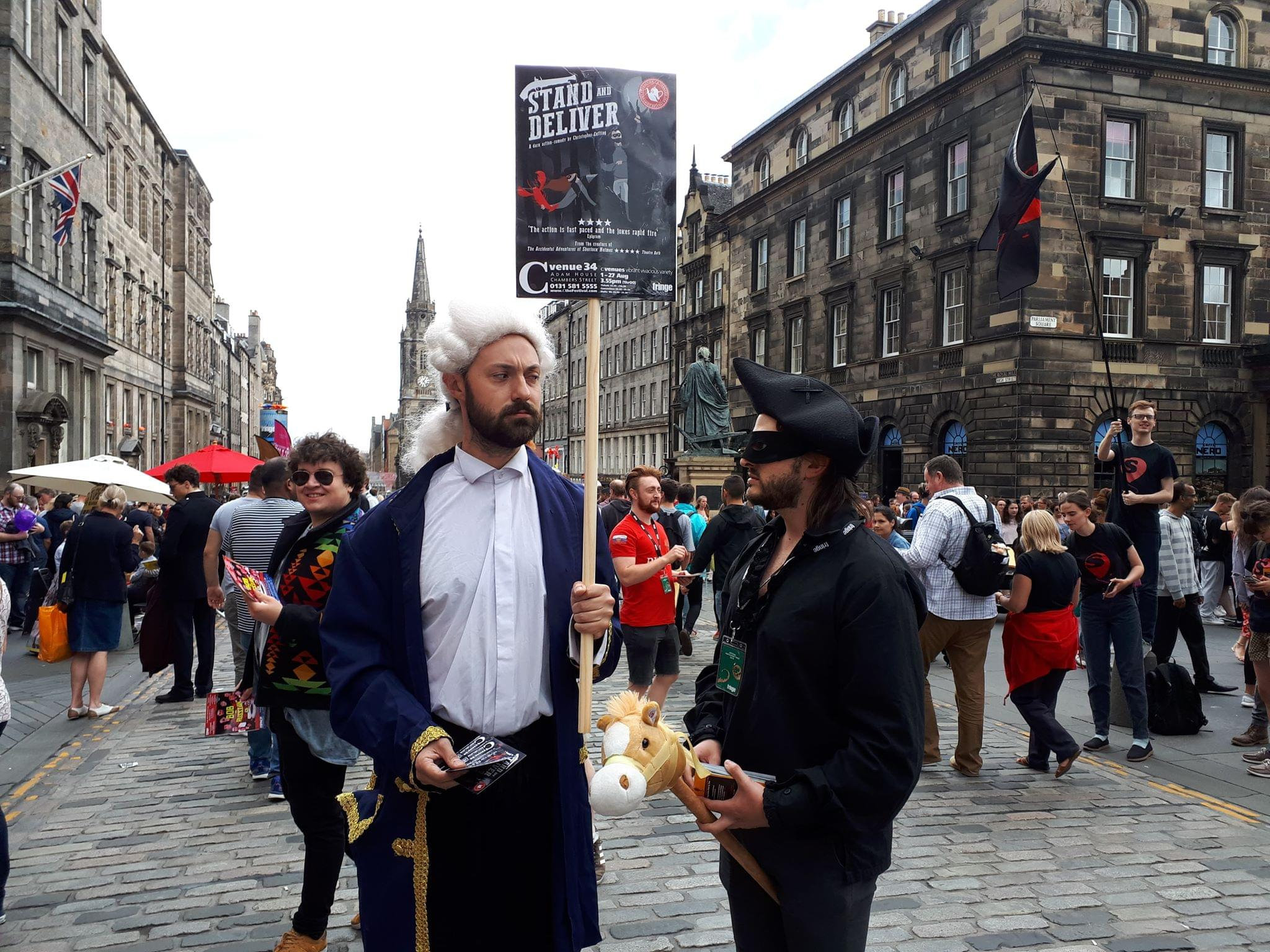 Joey Bartram and Ashley Shires, flyering for Stand and Deliver at Edinburgh Fringe Festival
