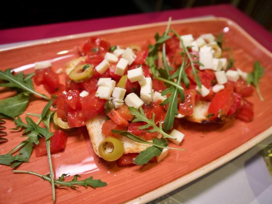 Fresh bread, tomatoes, cheese and arugula