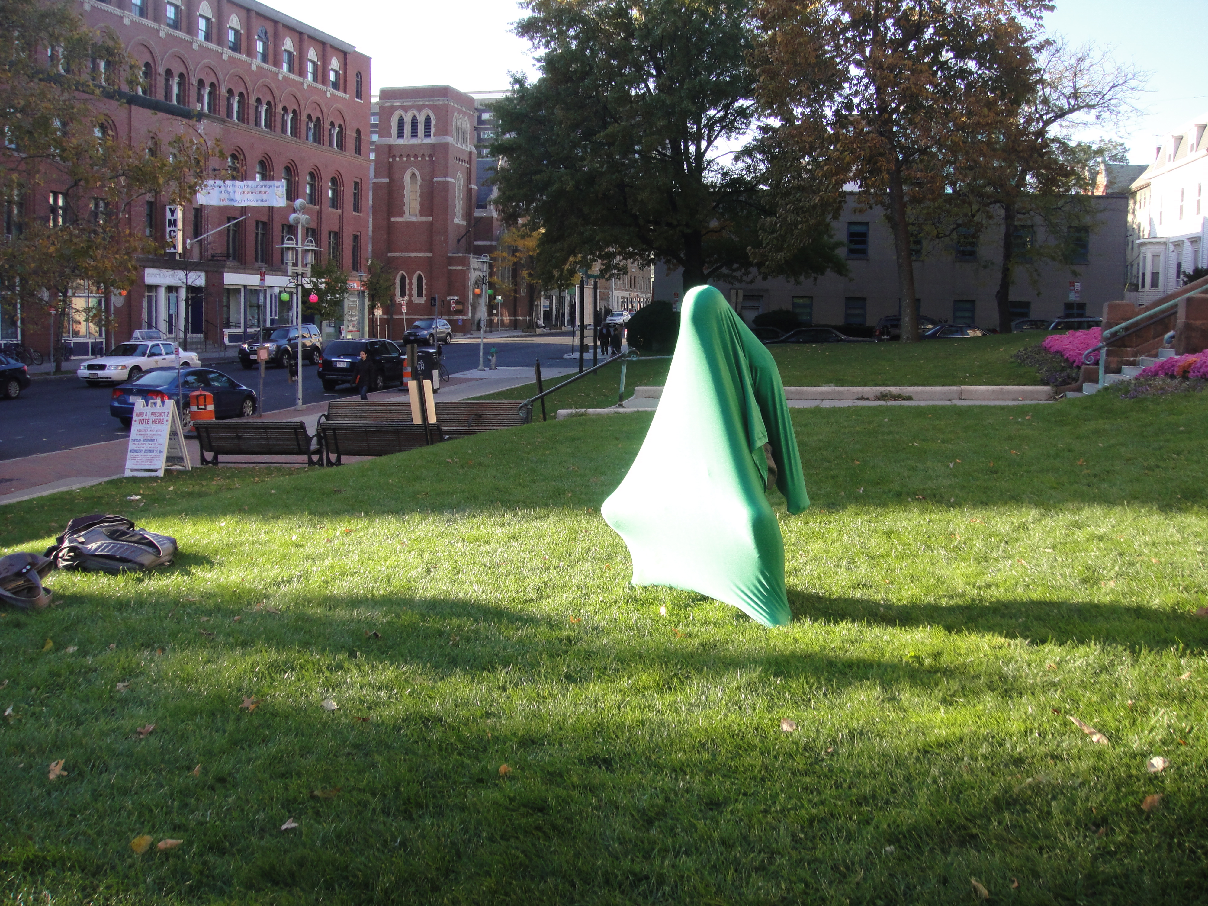 A wearer inside the sock on a vast green space stretches and bends her knees against the lycra, dancing with its form.