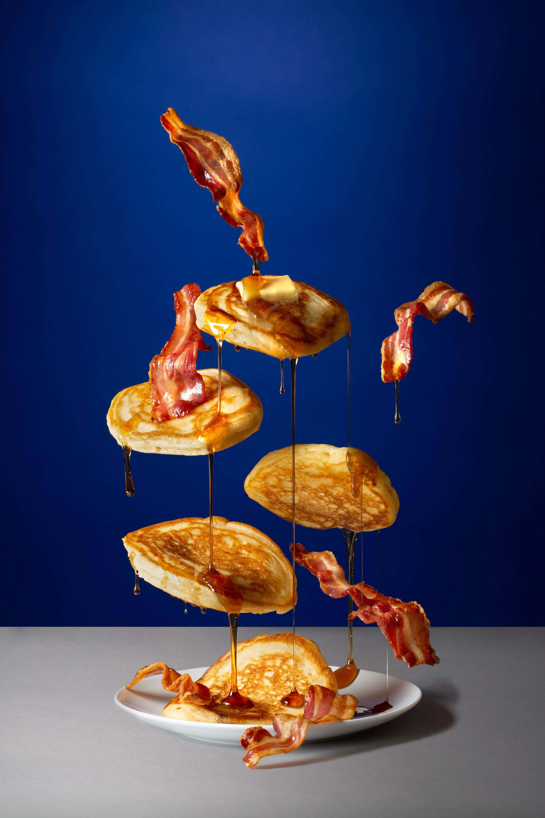 flying pancakes with butter and syrup