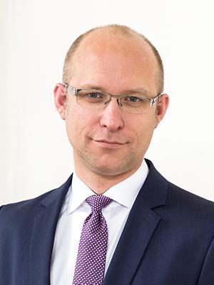 Dr. Christian Laux