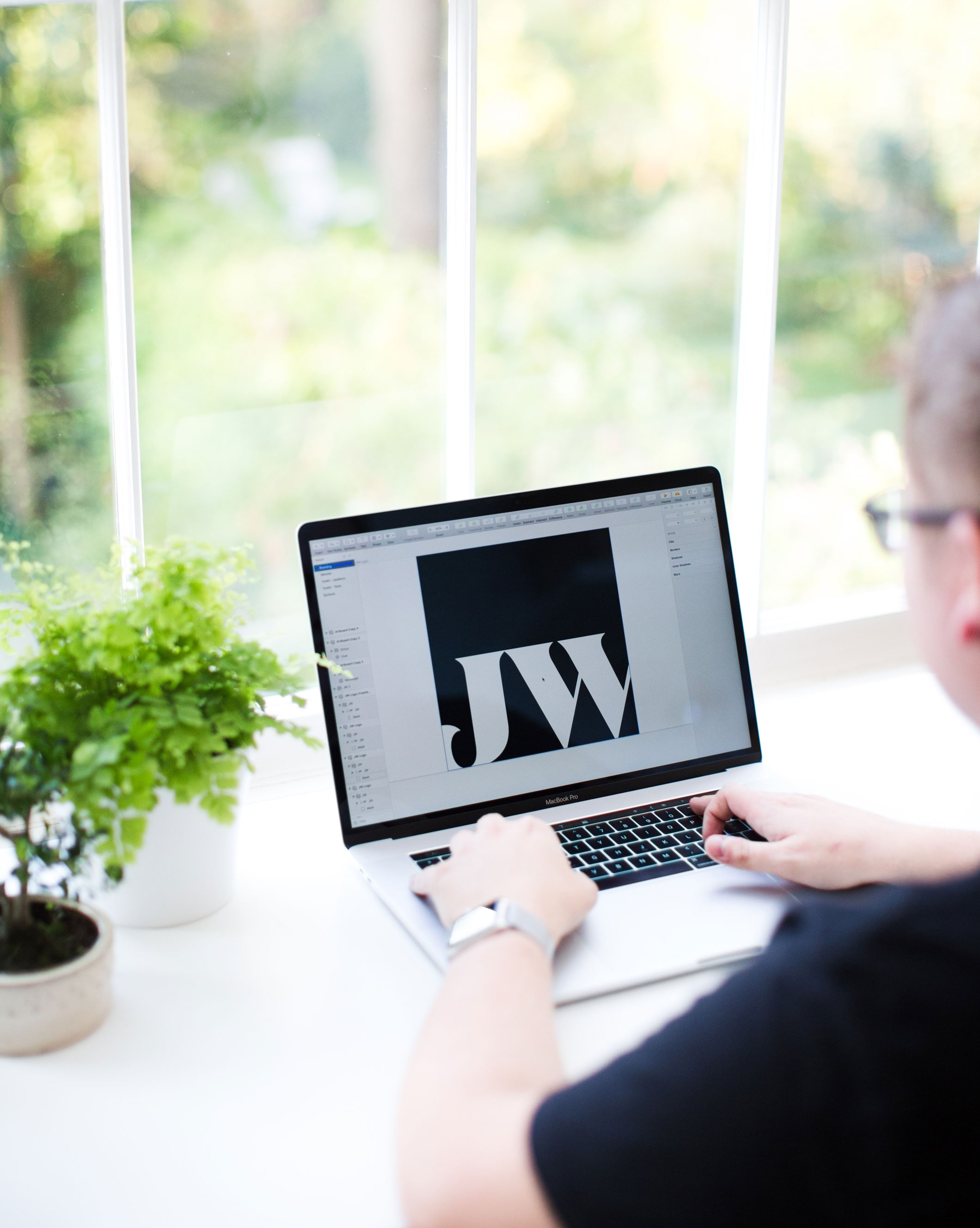 Jack Watkins working at his light filled desk and workspace