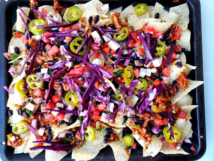 Nachos with vegetable toppings