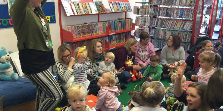Children and parents at a story and activity session
