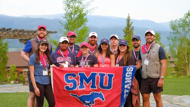 A group of people holding SMU flag