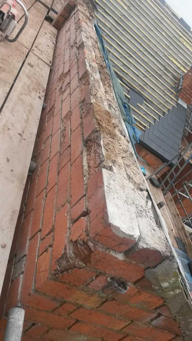 A roof ridge in poor condition of a property in the city centre of Worcester