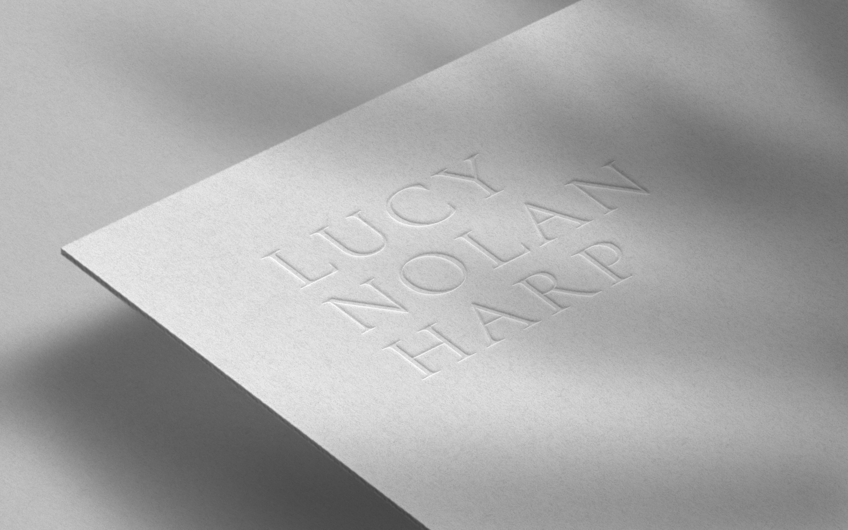 Embossed logo design on textured card for classical musician and harpist, Lucy Nolan