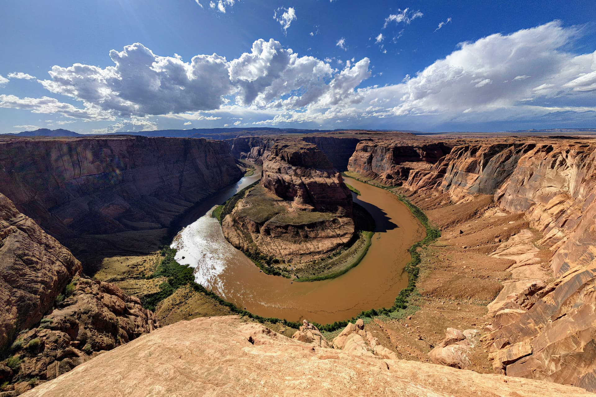 A wide-angle shot of the iconic Horseshoe Bend in the Colorado River (technically within the Grand Canyon National Park, as the park extends from the rim wall to the River all the way to the Glen Canyon Dam).