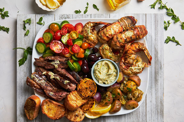 Grilled Lobster Tail and Steak Platter With a Greek Chimichurri Butter