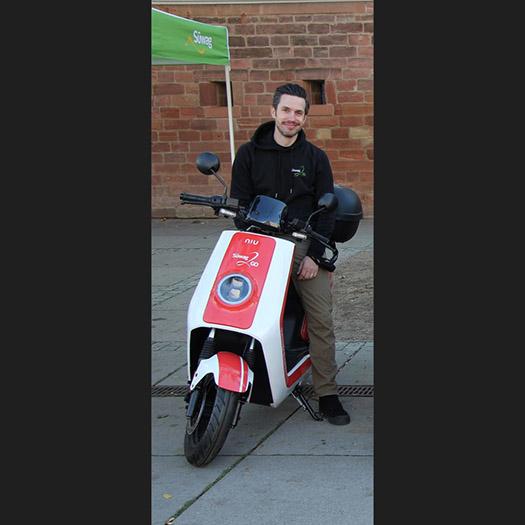 David Wiethoff sitting on electic bike at the street.