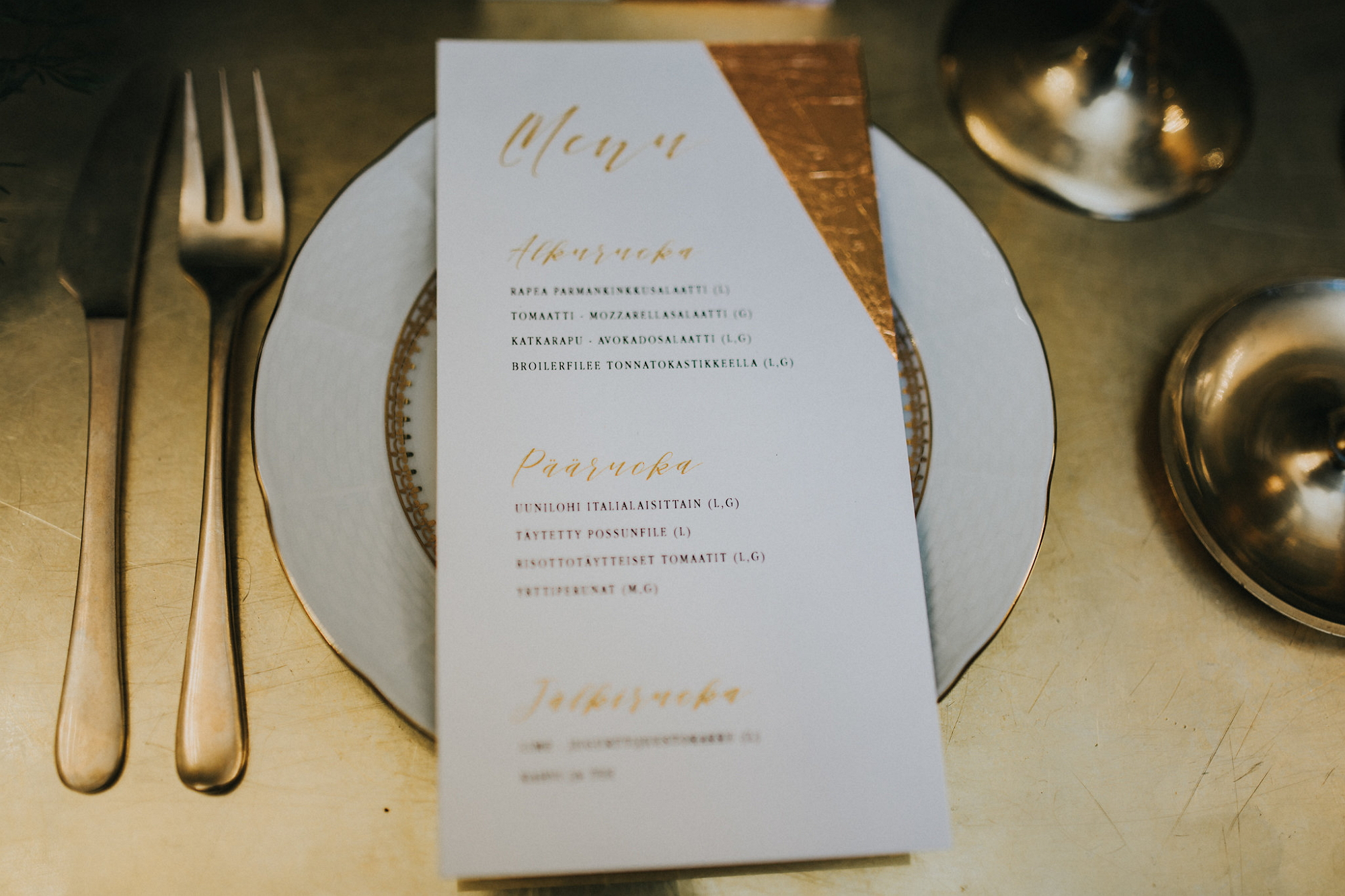 menu with hand-made golden decoration, photo by Marissa Tammisalo item