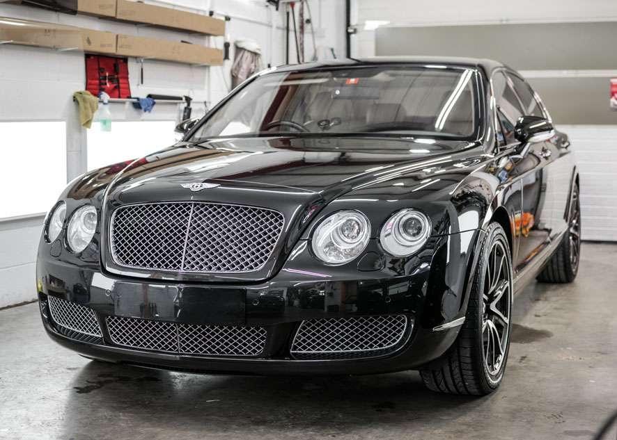 Shiny Bentley Flying Spur car after paint correction, paint correction, paint enhancement and headlight restoration