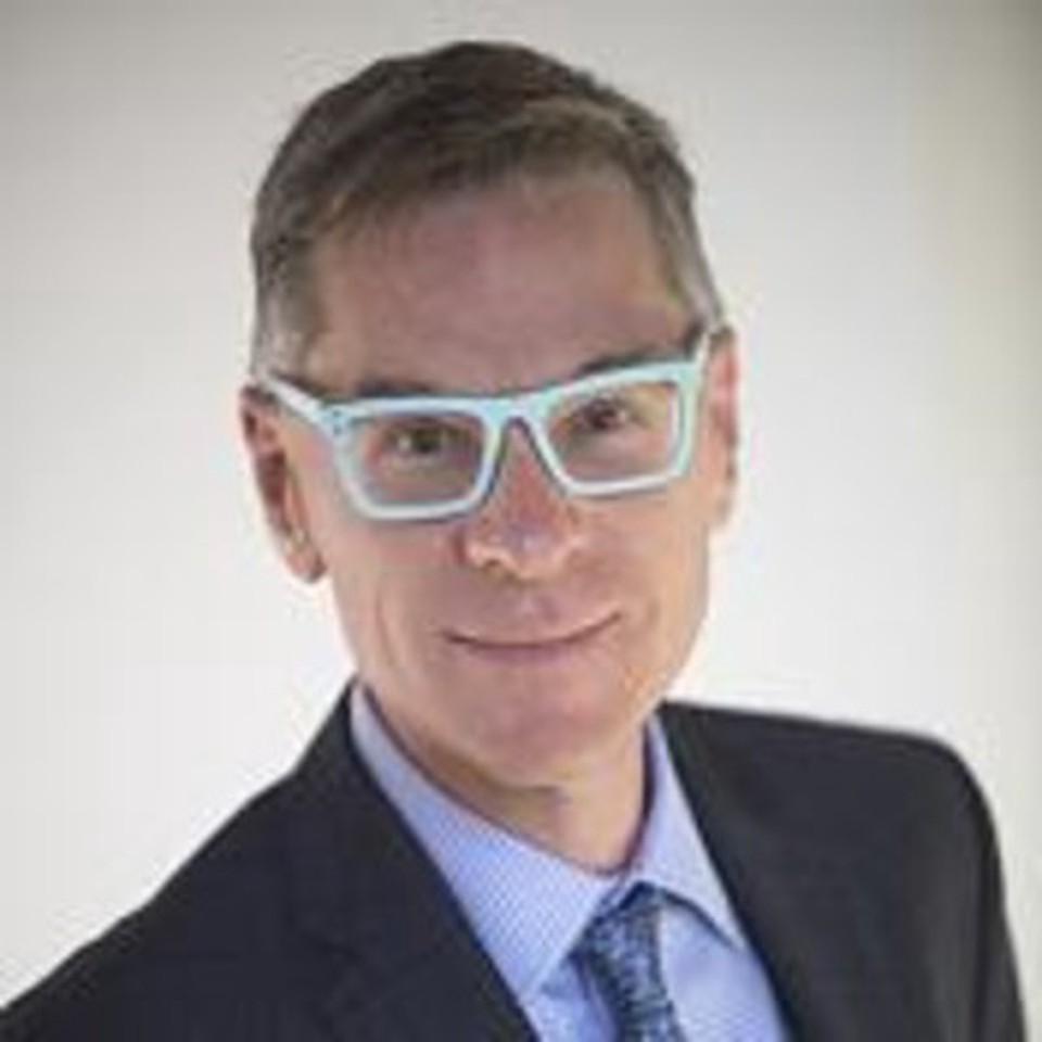Dean Bornick - in a suit with light blue glasses