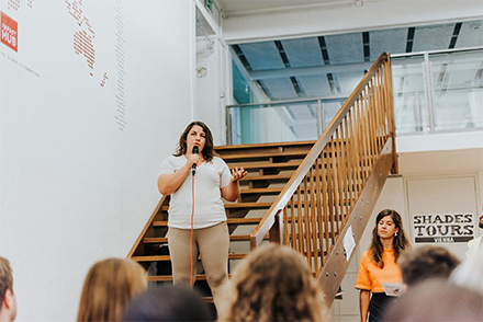 Natalie giving a speech at an event about migration organized by Impact Hub