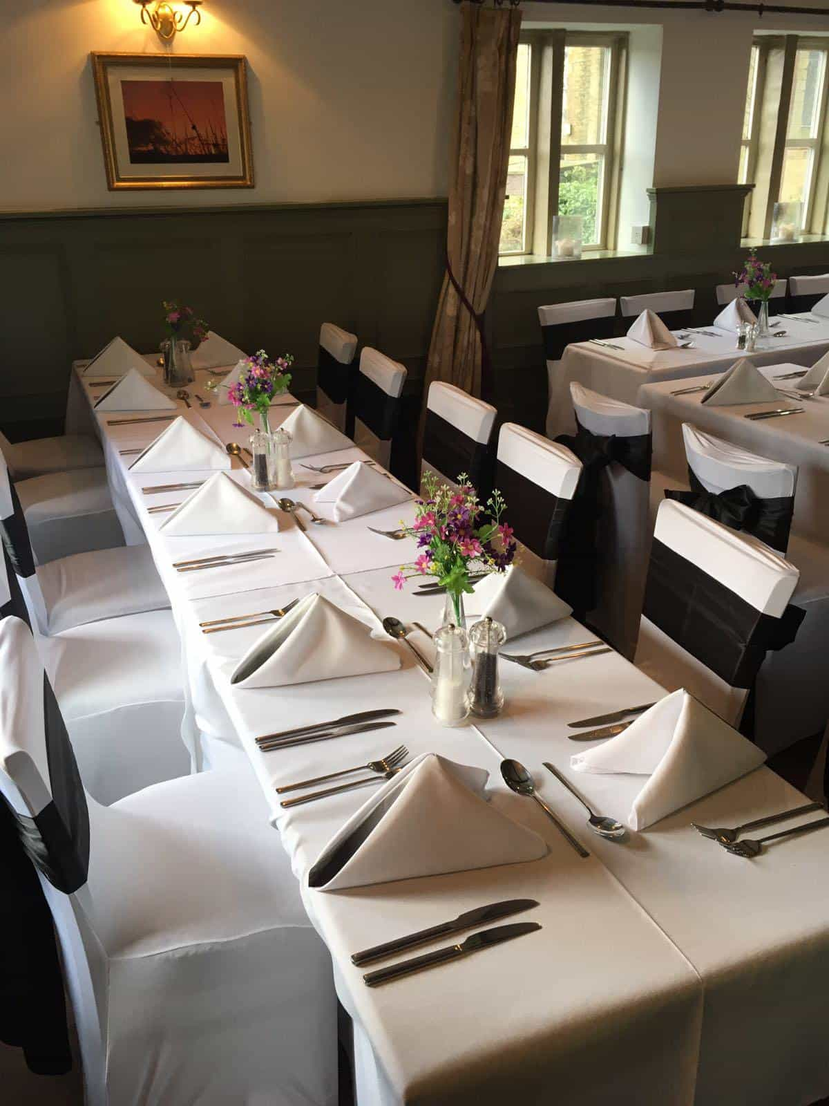 Simple black and white decoration for a wedding breakfast in a pub