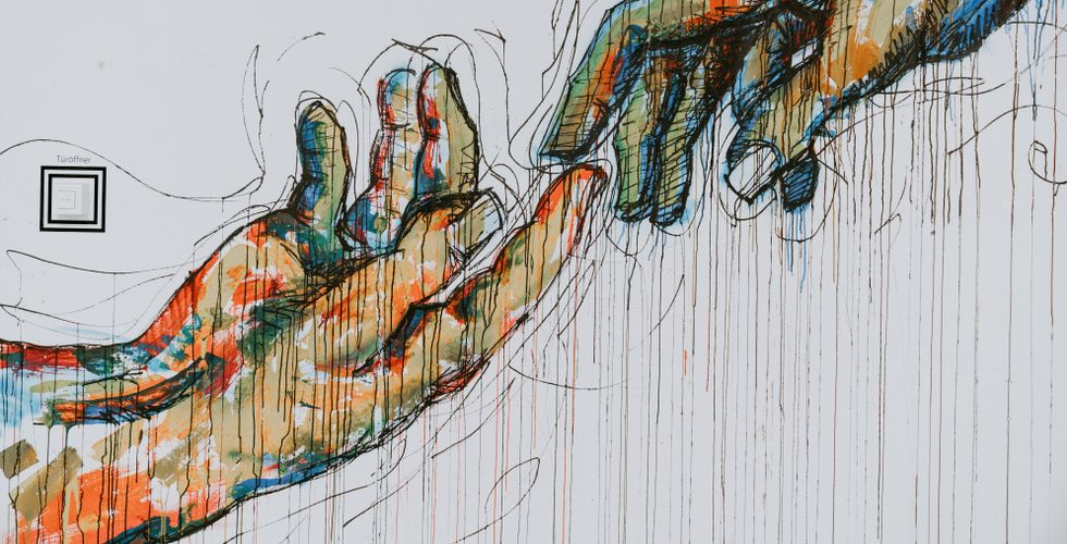 modern recreation of famous painting where adam and god's fingers are touching