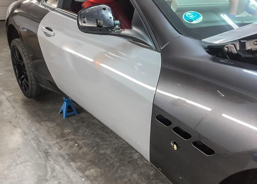 Maserati GranTurismo car being vinyl wrapped in khaki green
