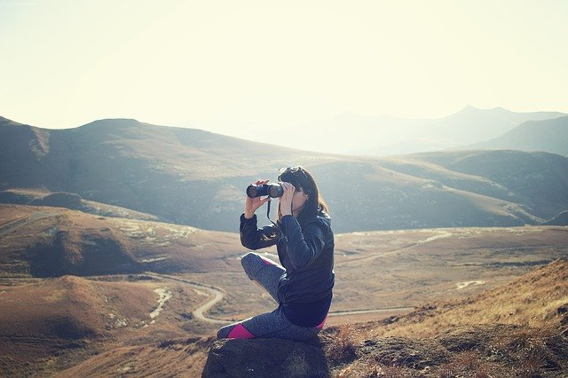 Person with binoculars