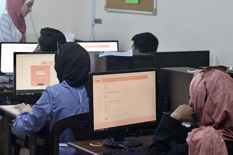 Students working at a computer on a Mosaik guidance tool
