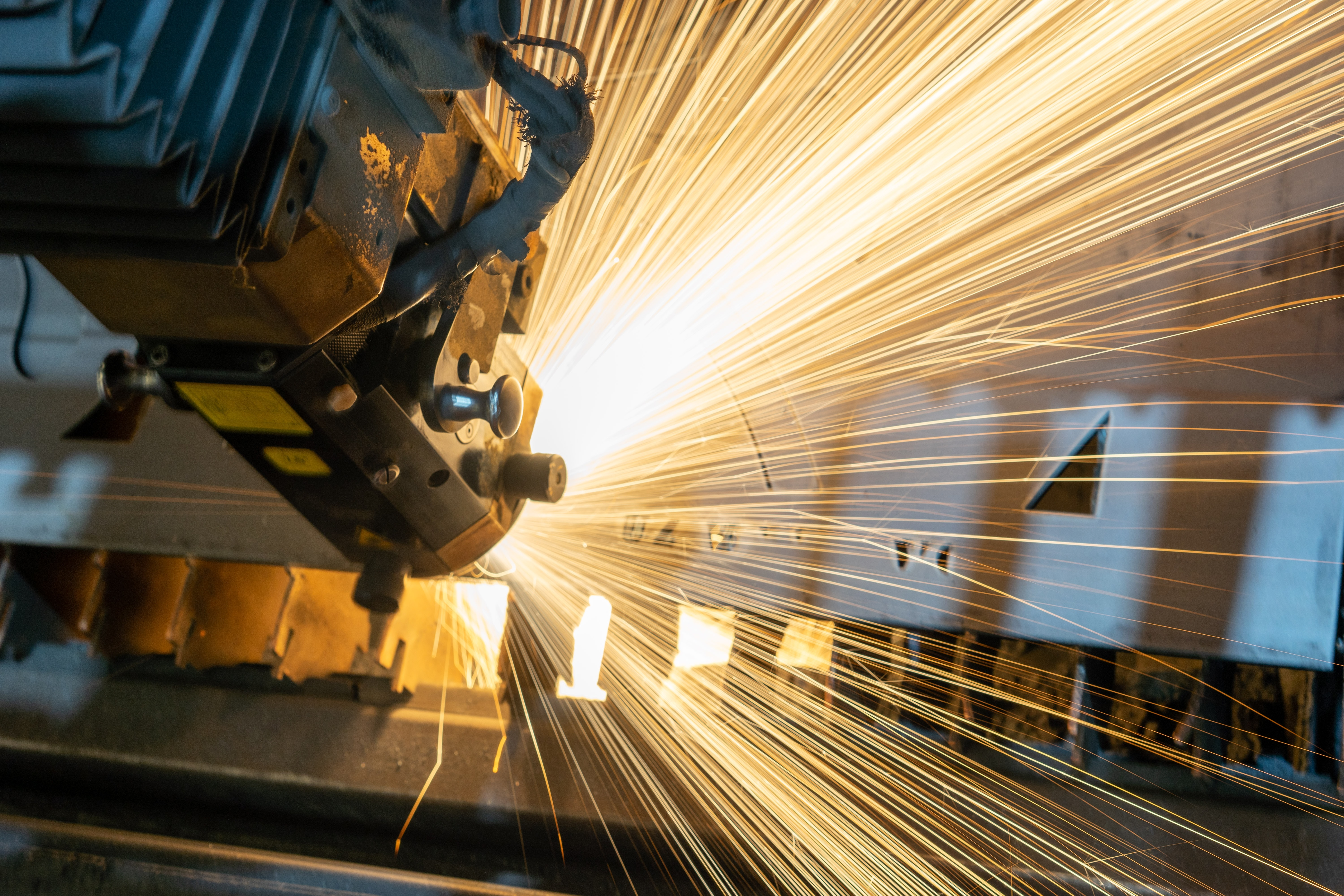 Sparks flying out of manufacturing machine