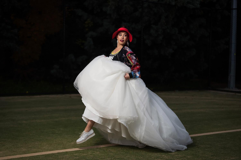 Bride on tennis court in red hat