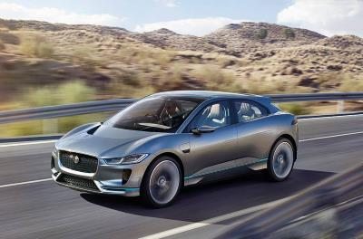 The Jaguar I-Pace driving along a fairly empty road