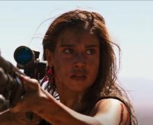 Jen (Matilda Lutz) stalks one of the men who did her wrong on a desolate desert road.
