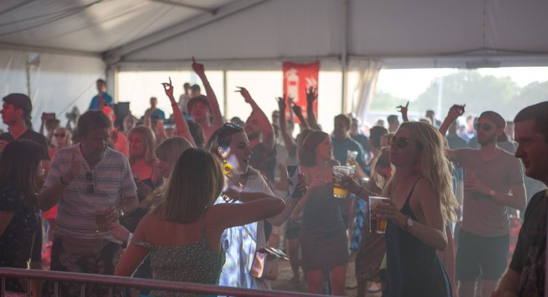Cusomters dancing in the Stage Tent at the 2018 summer festival