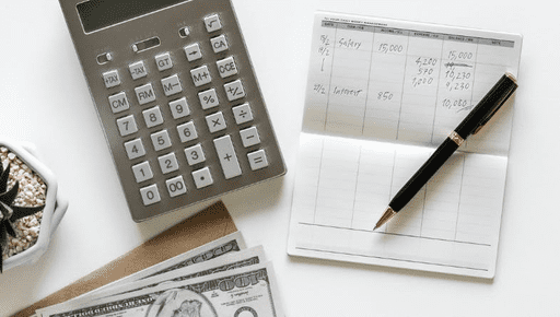 Calculator, notepad, pen, money and plant lie on white desk as business owner, bookkeeper, accountant generates cashflow from existing clients #cashflow