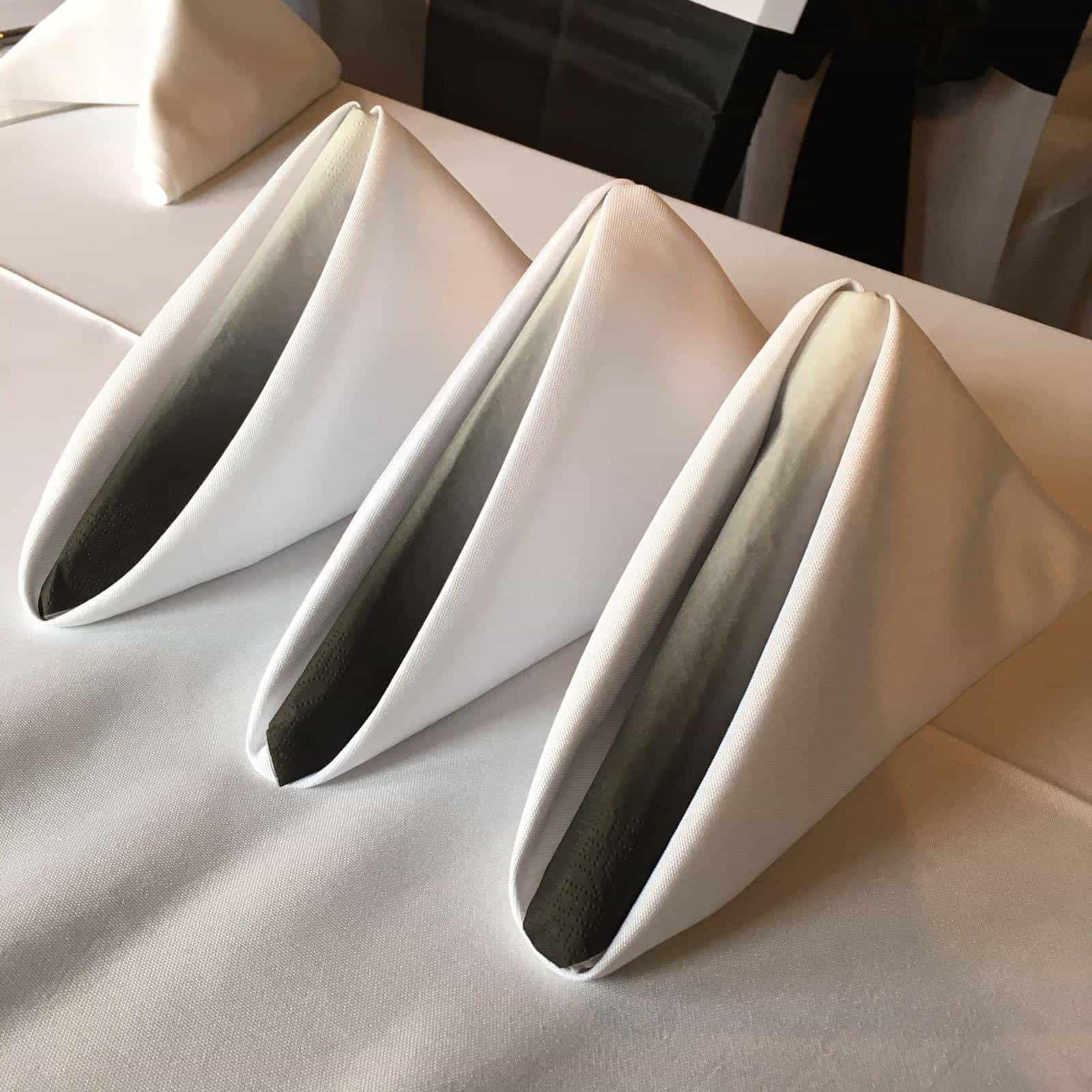 three dinner napkins folded nicely