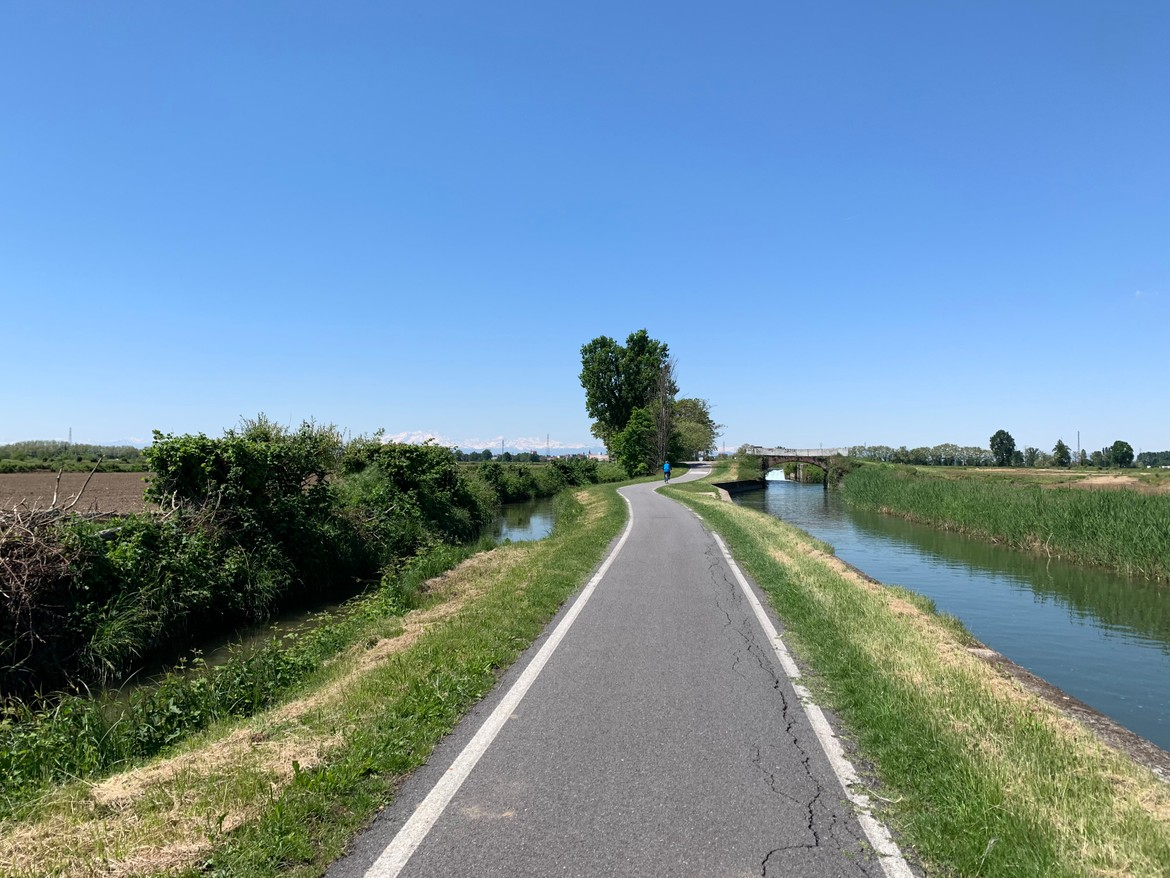 Amazing canal-side bike paths with Alps in the back
