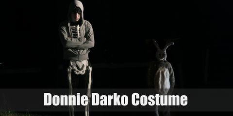 """Donnie Darko dresses up in a simple costume of a skeleton full body suit with a gray hoodie over the top. This costume is very simple and fits his moody-don't care-troubled teenager attitude""."