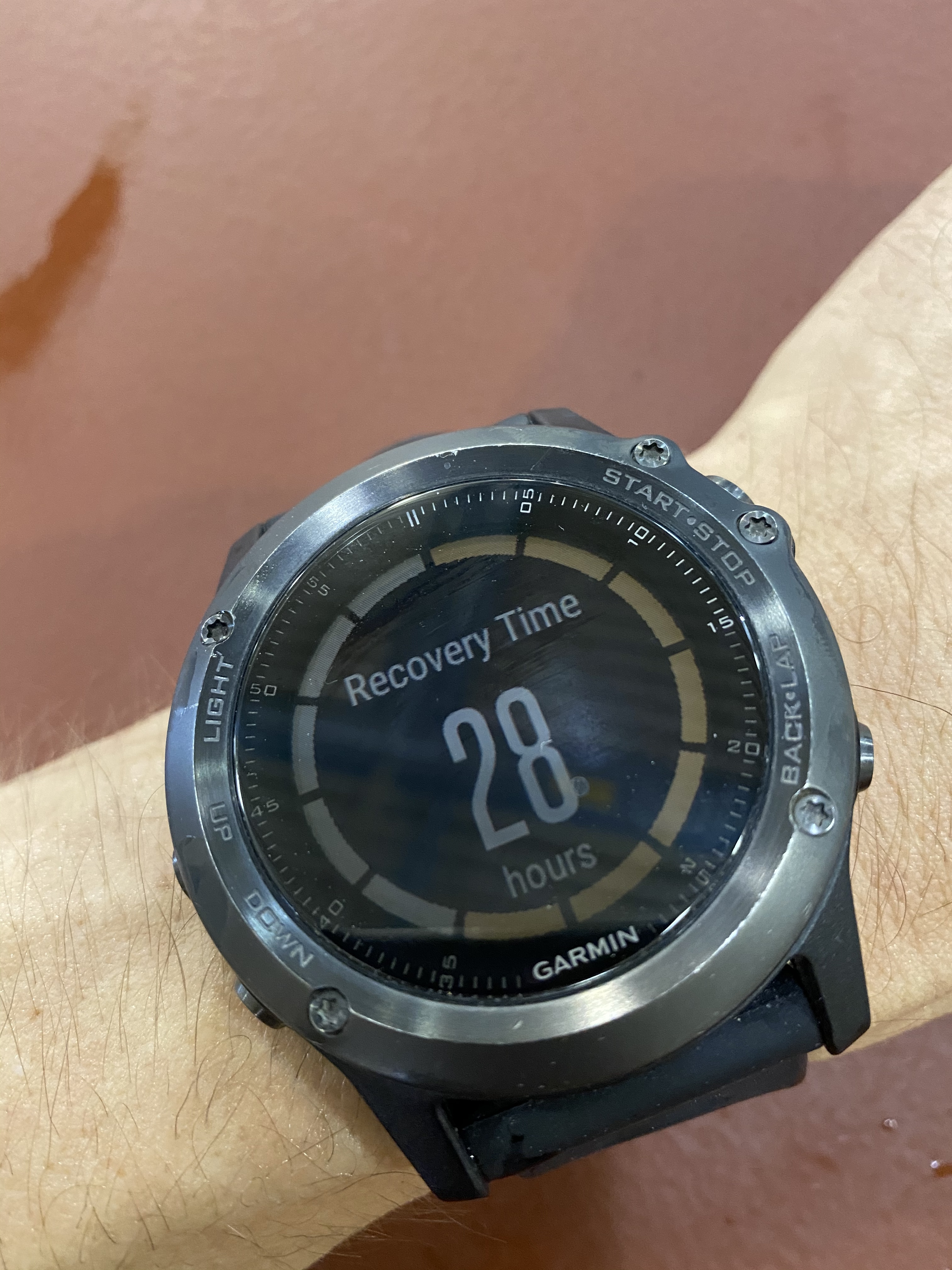Garmin watch showing recovery time of 28 hours