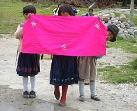 children-selling-crafts-in-ecuador