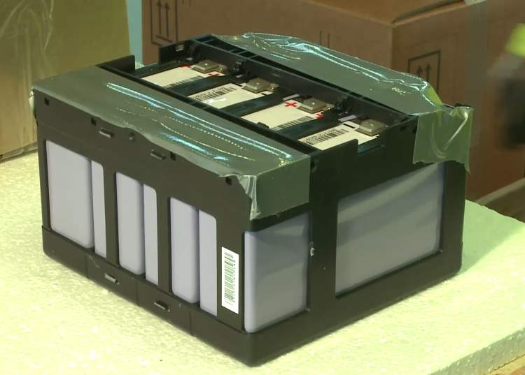 A bigger battery module in a plastic frame.