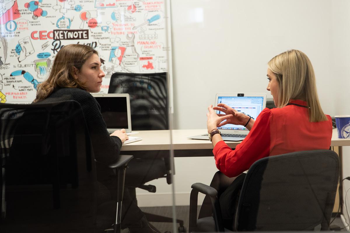 Women talking in office