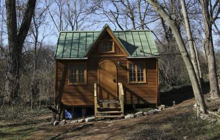 Front view of the Nashville Wonderland tiny home, in its forest surroundings