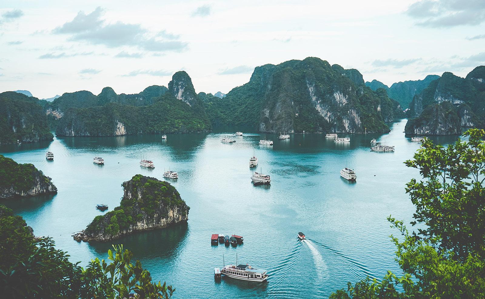 boats and limestone columns in halong bay, vietnam
