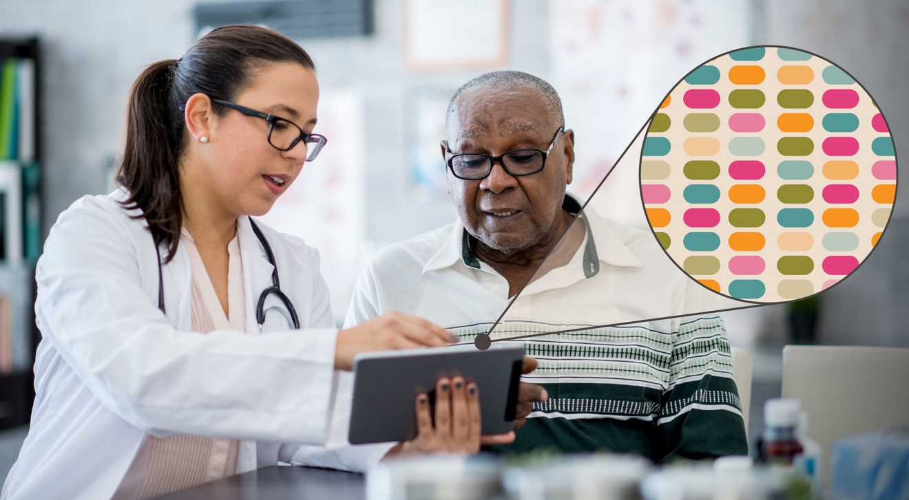 A doctor and a senior patient look at the patient's personalized genomic sequencing results on a tablet in a doctors office