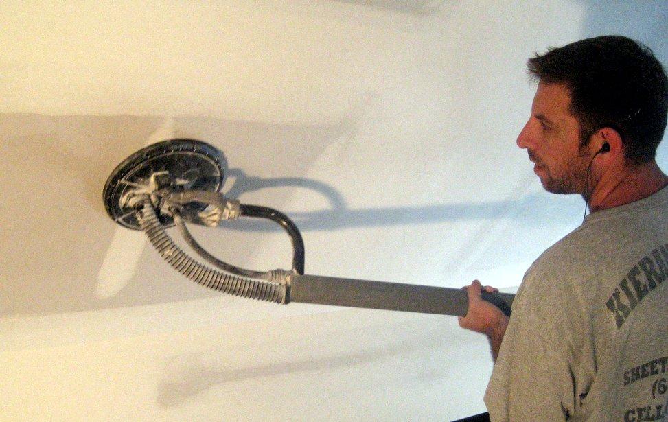 Long Island spackler using drywall sander