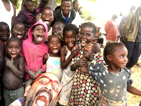 Ashish making silly faces with children