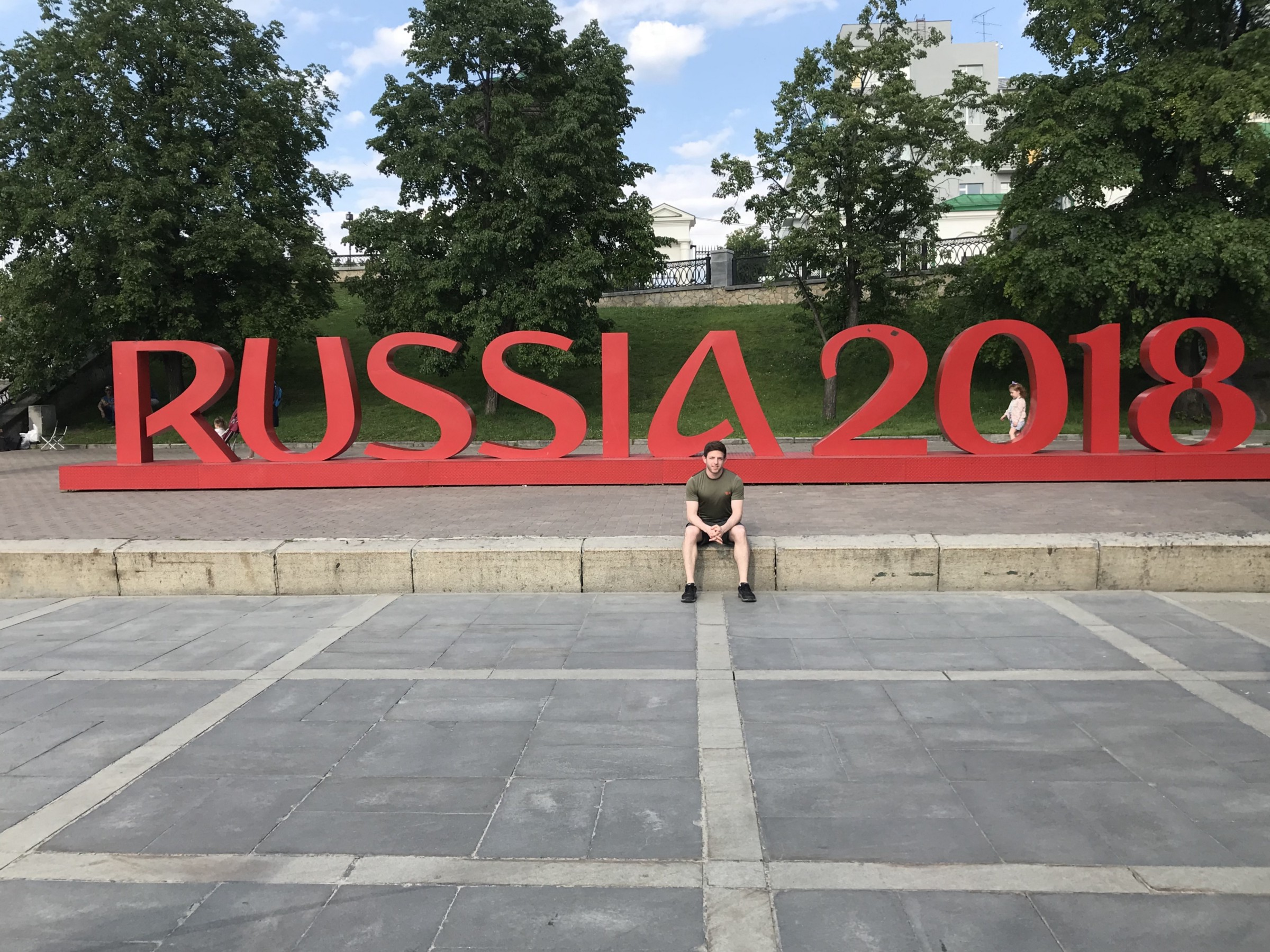 """Posing in front of a """"Russia 2018"""" sign that was put up for the World Cup."""