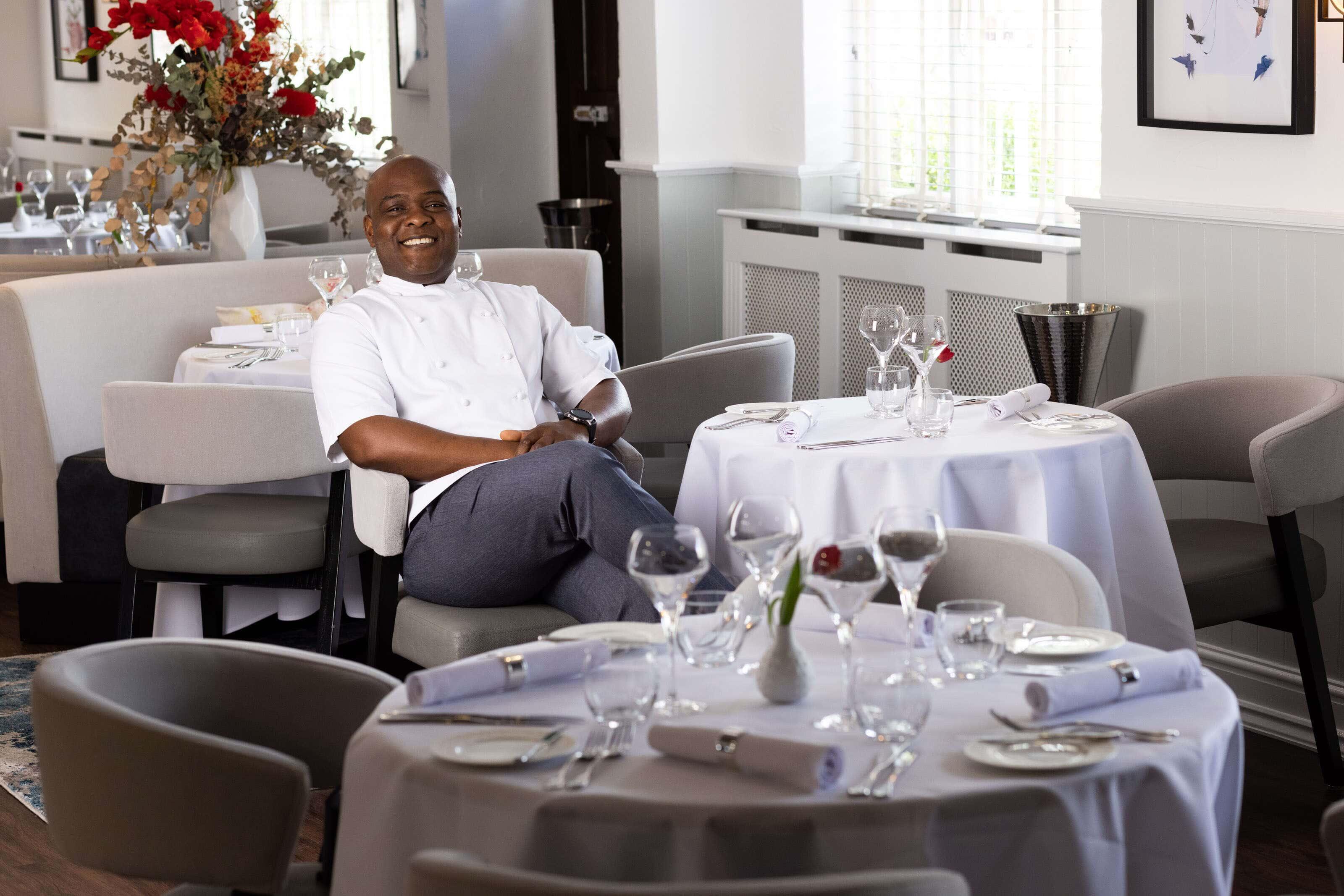 chef Adebola Adeshina sat in his restaurant the Chubby Castor